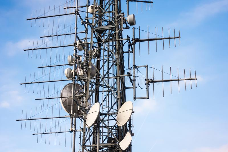 Telecommunication mast TV antennas wireless technology with blue sky in the morning.  stock image