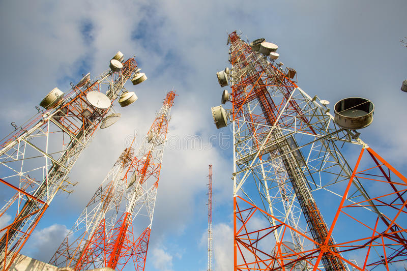 Telecommunication mast TV antennas wireless technology. With blue sky in the morning stock photos