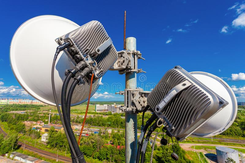 Telecommunication mast with wireless communications systems are including microwave antennas, fider, optic and pow stock images