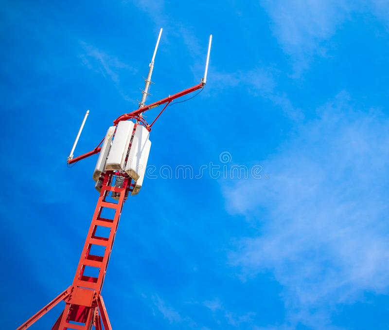 Telecommunication mobile phone communication repeater antenna isolated. Telecommunication mobile phone communication repeater antenna under blue sky with space stock images