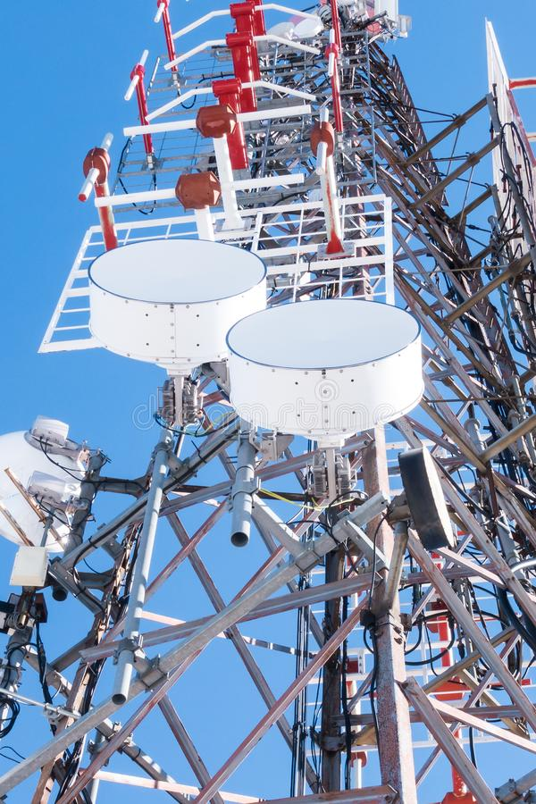 Telecommunication network repeaters, base transceiver station. Tower wireless communication antenna transmitter and repeater. stock images