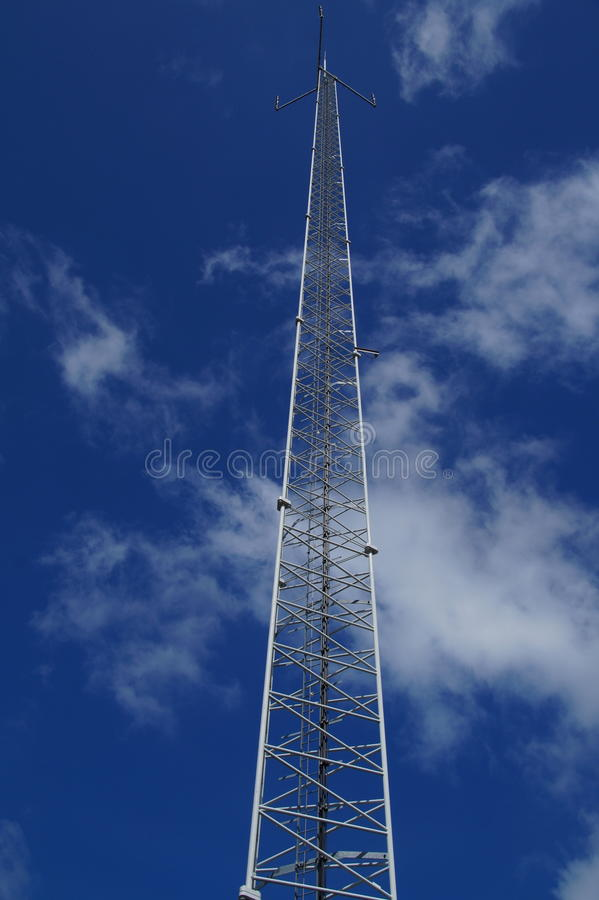 Telecommunication pole with antenna 4G. Telecommunication pole with antenna (3G 4G) against a cloudy blue sky royalty free stock photos