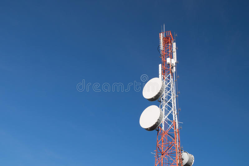 Telecommunication pole. With blue sky background royalty free stock photos