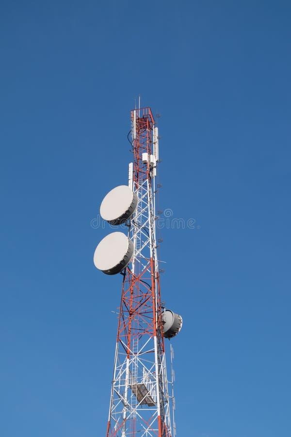Telecommunication pole. With blue sky background stock image