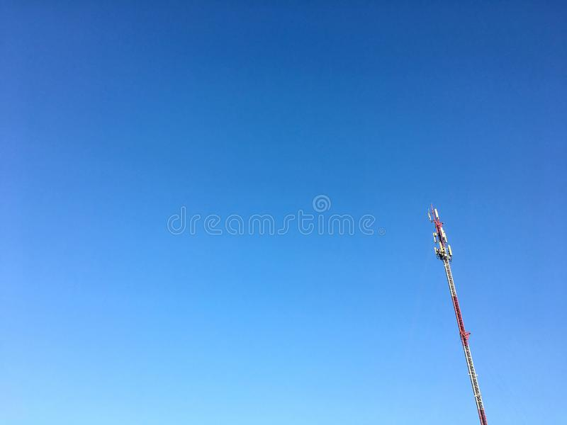 Telecommunication pole with cleared blue sky background. Photo of Telecommunication pole with cleared blue sky background stock image