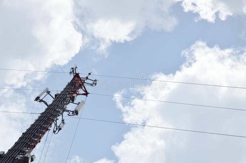 Telecommunication pole on cloud and sky in sunny day stock images