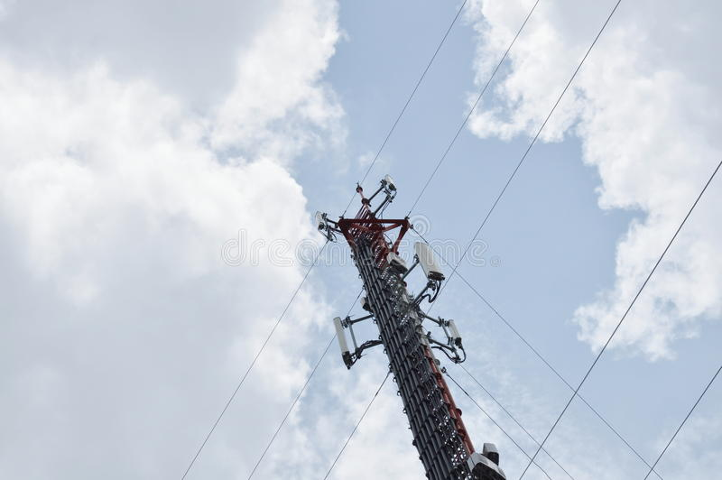 Telecommunication pole on cloud and sky in sunny day. Telecommunication pole on the cloud and sky in sunny day stock photo
