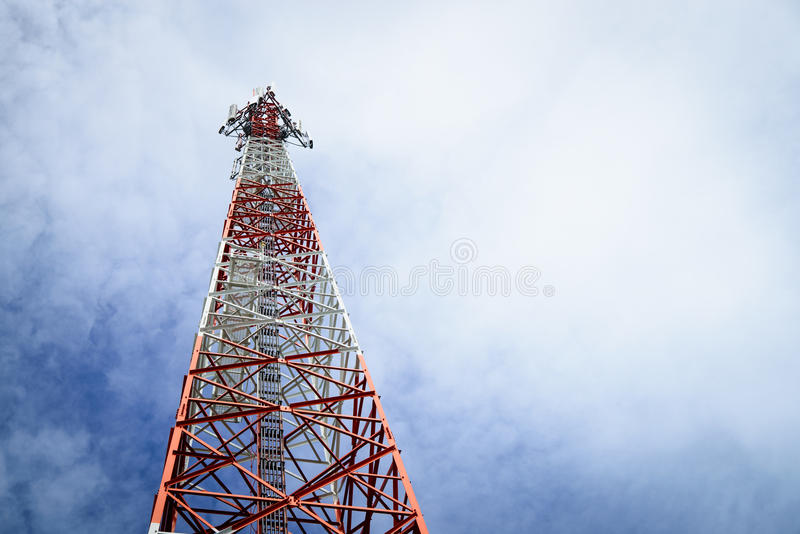Telecommunication pole. In the cloudy day background royalty free stock images
