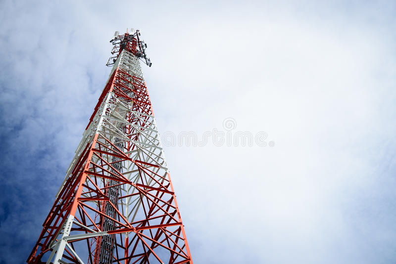 Telecommunication pole. In the cloudy day background stock photo