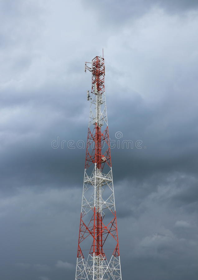 Telecommunication pole tower in cloudy sky. Telecommunication pole tower with cloudy sky stock photos