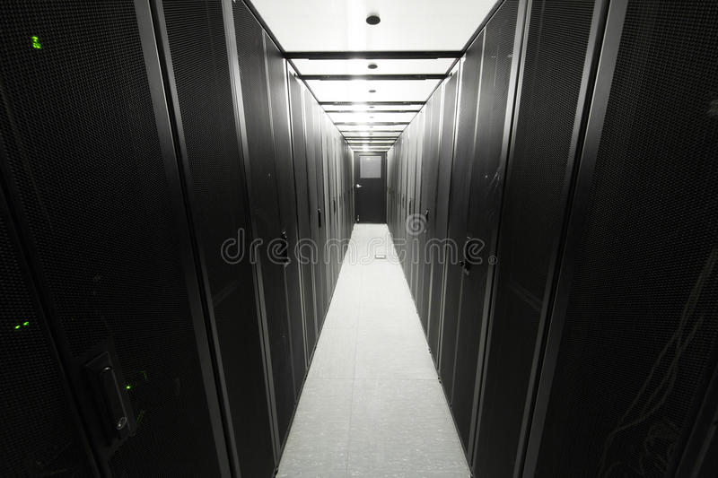 Telecommunication racks. Are symmetrically in a sealed corridor royalty free stock image