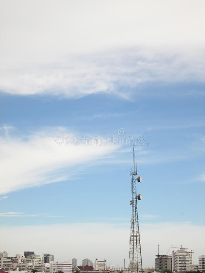 Telecommunication Radio Antenna and Satelite Tower with blue sky. Outdoor stock photography