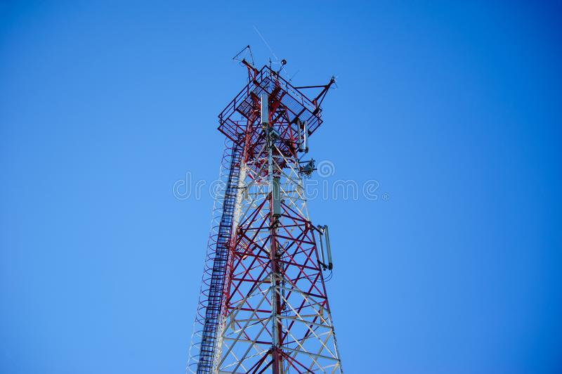 Telecommunication radio signal tower over the blue sky stock photos