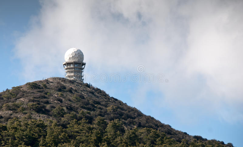 Telecommunication repeater station. At kionia area Kionia in Cyprus with mountains covered in snow stock photography