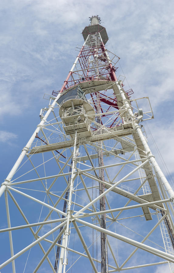 Telecommunication steel lattice tower against the sky stock photo