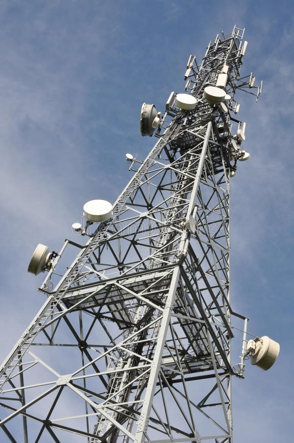 Telecommunication steel mast with antennas stock photos