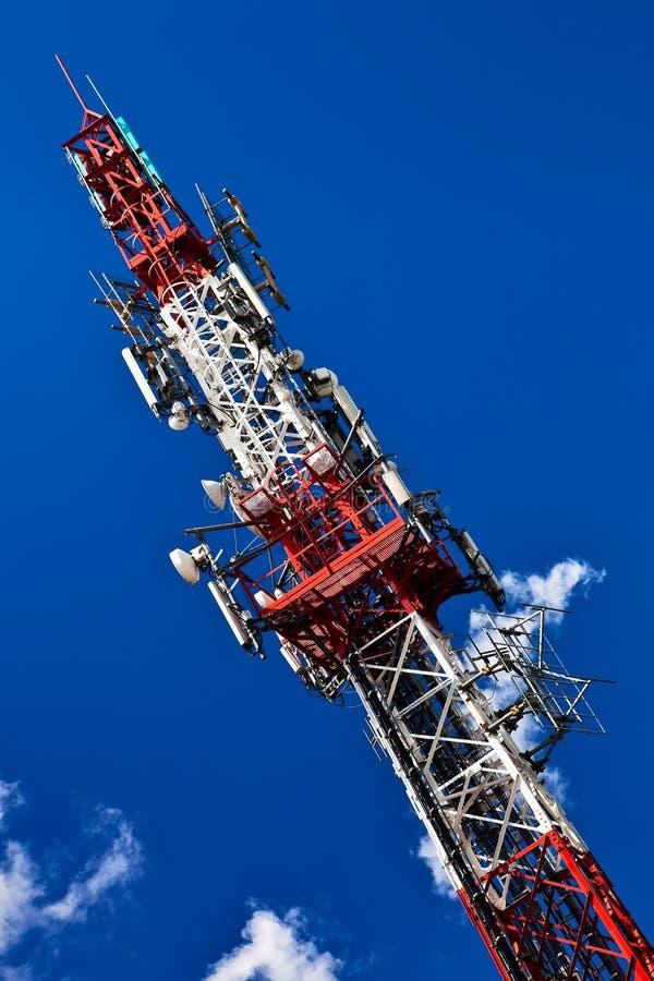 Telecommunication tower. Telecommunication tower with antennas over a blue sky royalty free stock photos