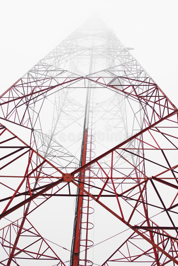Telecommunication tower. With antennas over a blue sky stock photos