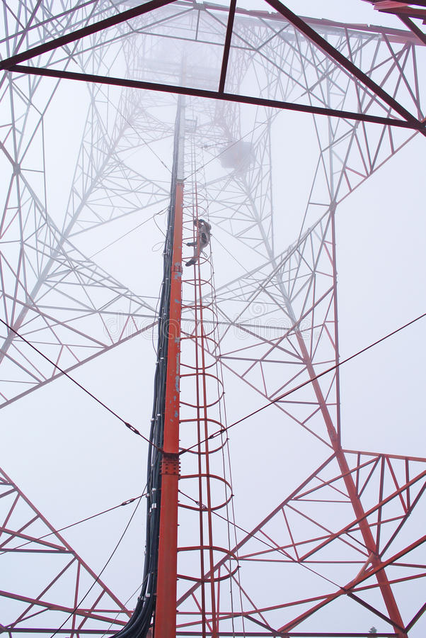 Telecommunication tower. With antennas over a blue sky stock photo