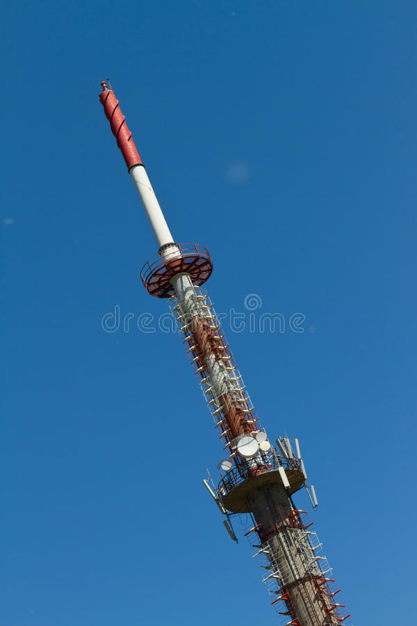 Telecommunication Tower. Red and White Telecommunication Tower stock images