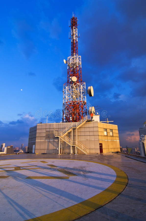 Telecommunication tower. With antennas on blue sky stock image