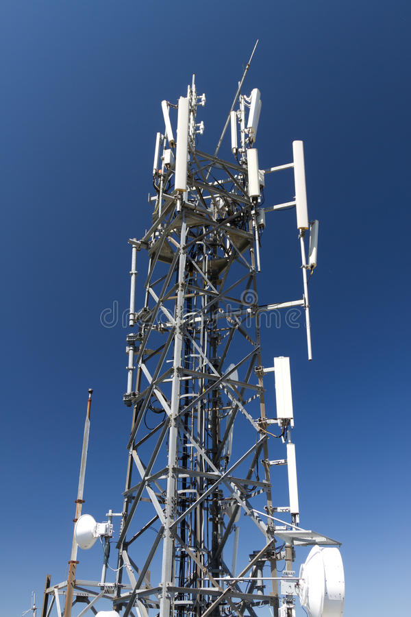 Telecommunication Tower. With blue sky background stock photo