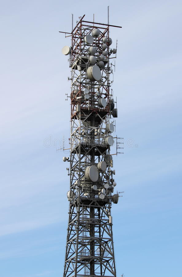 Telecommunication tower. With many different antennas royalty free stock photo