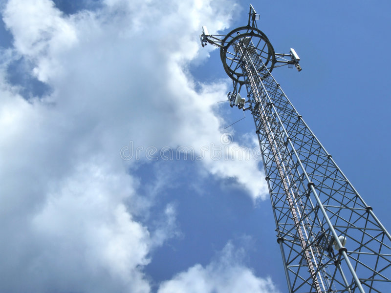 Telecommunication tower. Antenna details against cloudy sky royalty free stock image