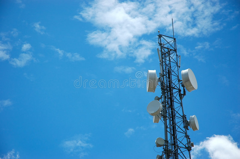 Telecommunication Tower. In the blue sky royalty free stock images