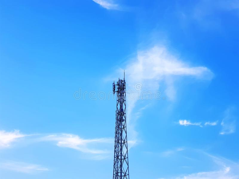 Telecommunication Tower Against Blue Cloudy Sky stock images