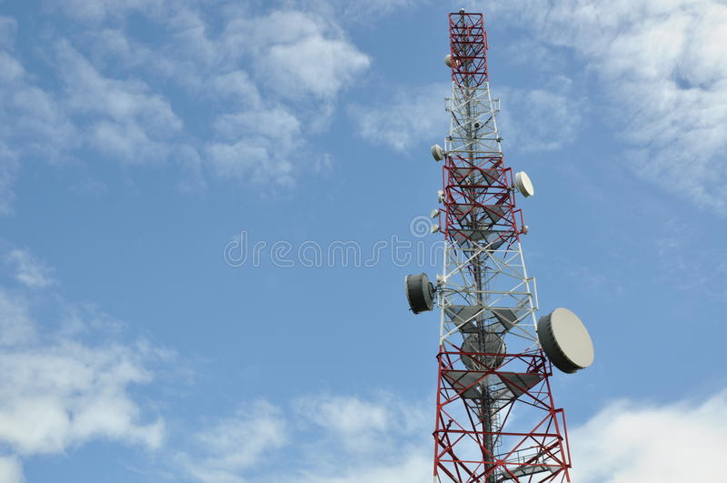Telecommunication tower. Against the blue sky royalty free stock image