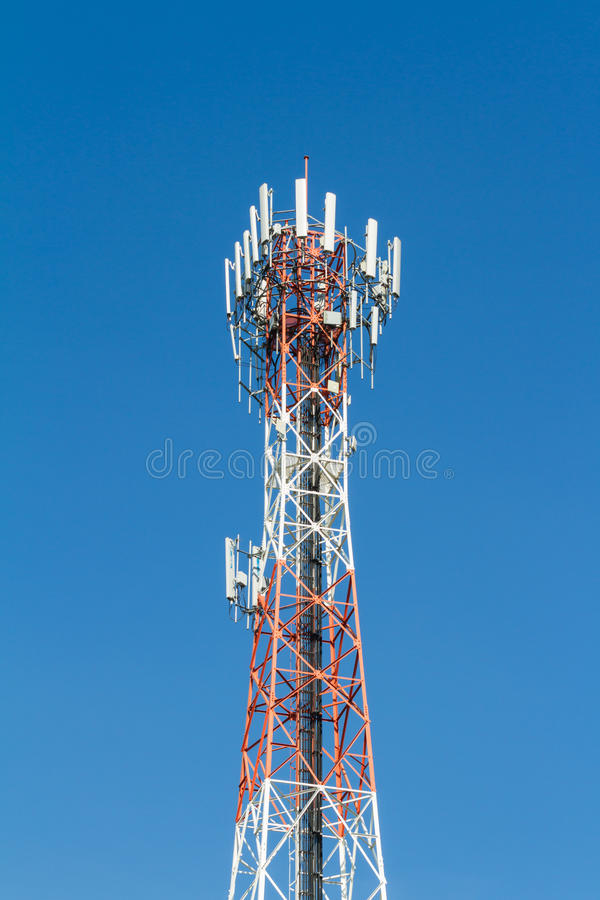 Telecommunication tower. Against blue sky stock image
