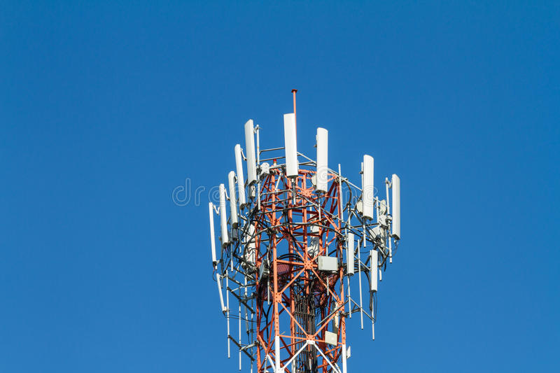 Telecommunication tower. Against blue sky royalty free stock photos