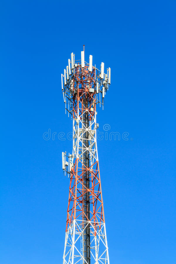 Telecommunication tower. Against blue sky stock photos