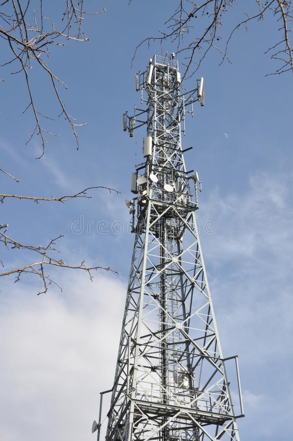 Telecommunication tower. Against blue sky royalty free stock image