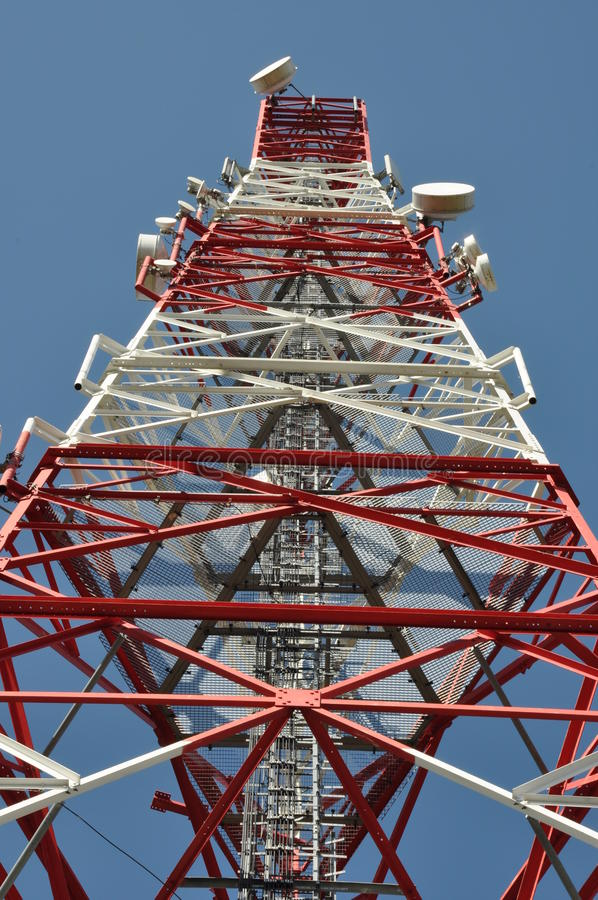 Telecommunication tower. Against the blue sky stock photos
