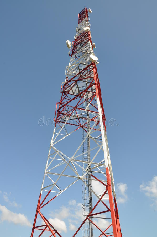 Telecommunication tower. Against the blue sky royalty free stock photos