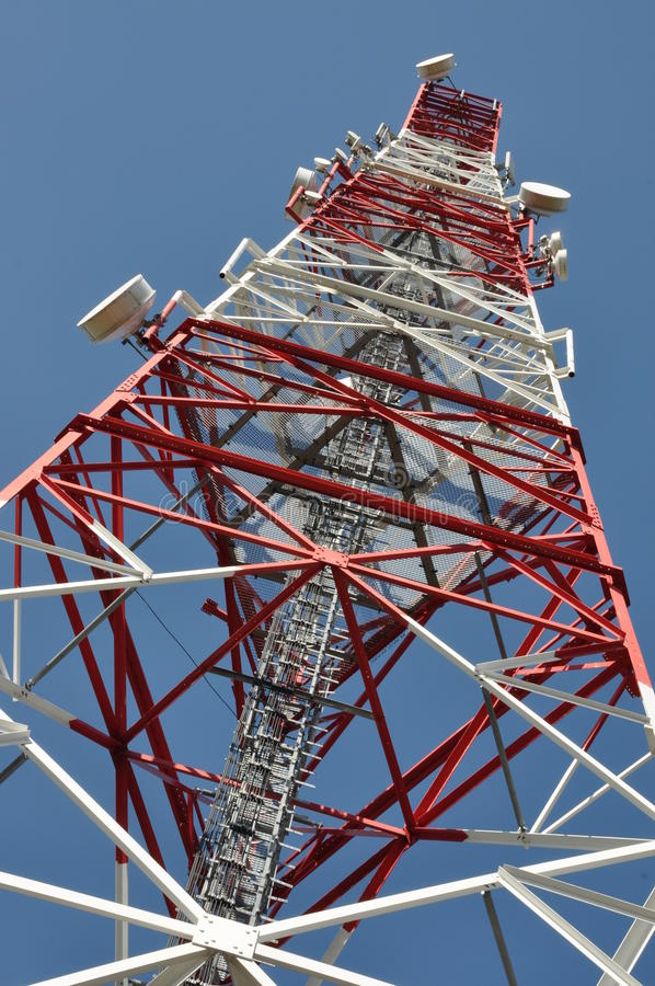 Telecommunication tower. Against the blue sky stock photo
