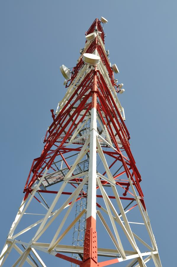 Telecommunication tower against the blue sky. Telecommunication tower against the blue and clear sky stock photography