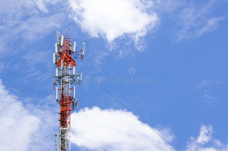 Telecommunication tower. Against cloudy sky royalty free stock photo