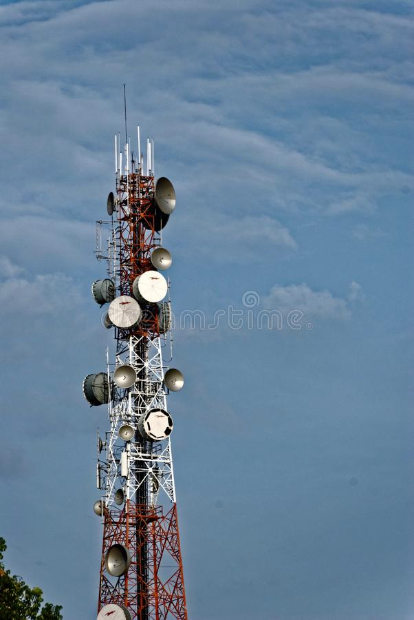 Telecommunication tower against the sky. Picture with copy space royalty free stock images