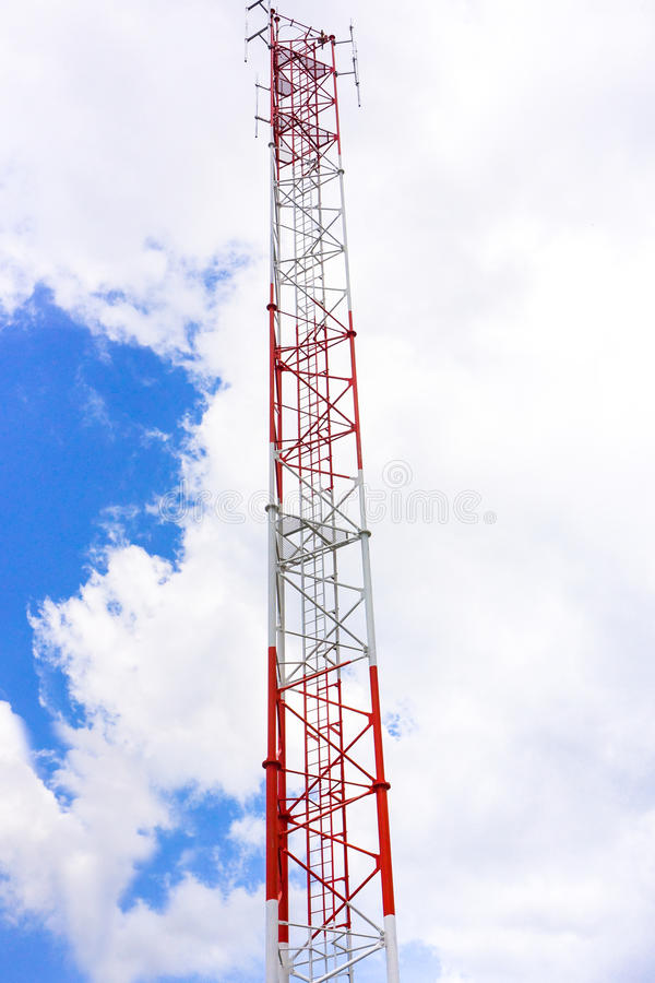 Telecommunication tower and antenna against the sky.  stock image