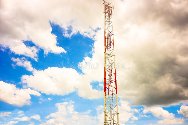 Telecommunication tower and antenna against the sky.  royalty free stock photo