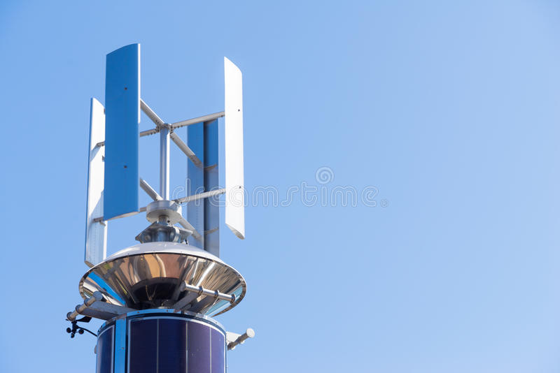 Telecommunication tower with antenna swiveling. With clear sky royalty free stock image