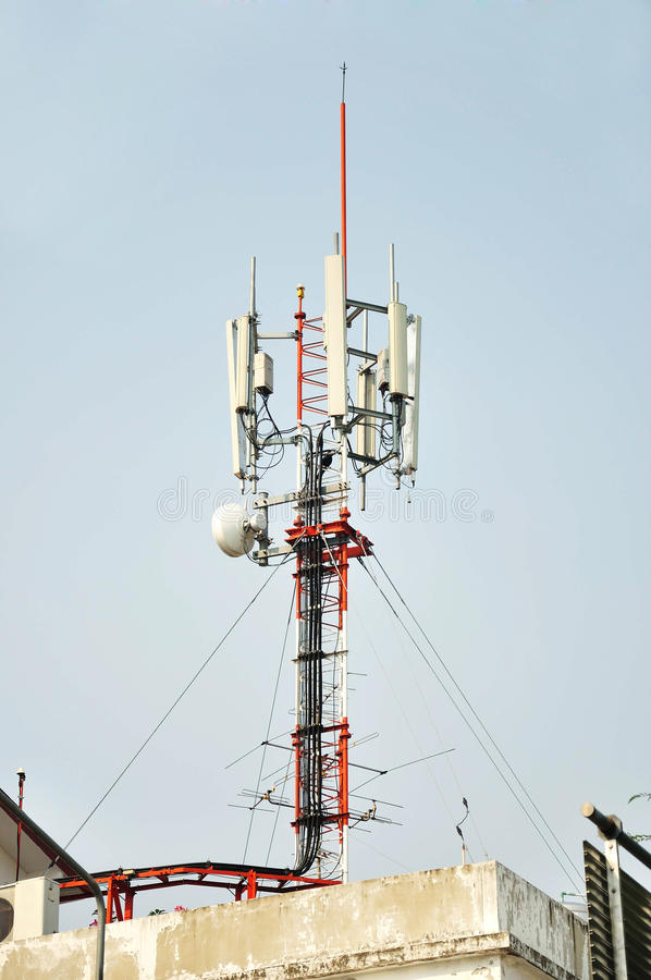 Telecommunication tower with antennas. Background stock photography