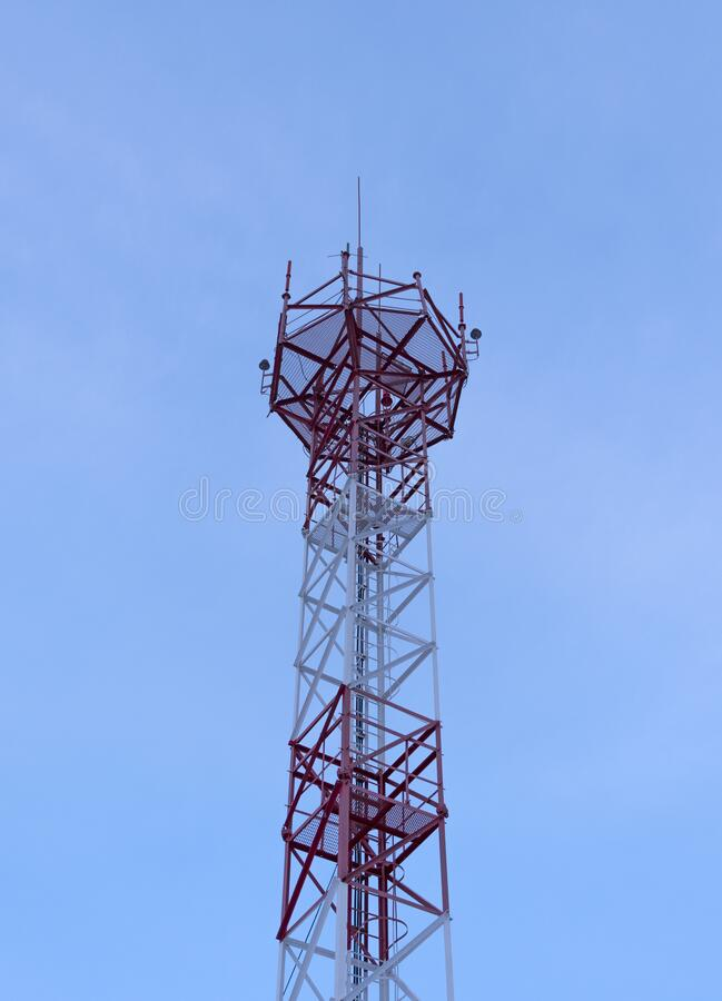 Telecommunication Room Design: Telecommunication Tower With Antennas Against With Blue
