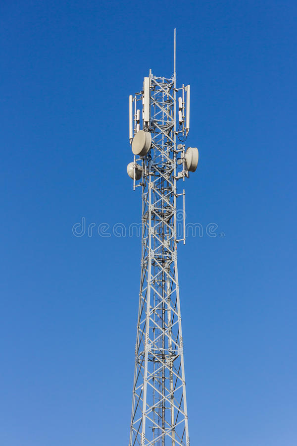 Telecommunication tower with antennas with blue sky.  stock images