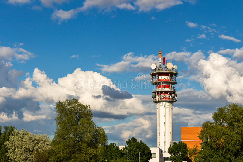 Telecommunication tower with antennas and blue sky.  stock photos