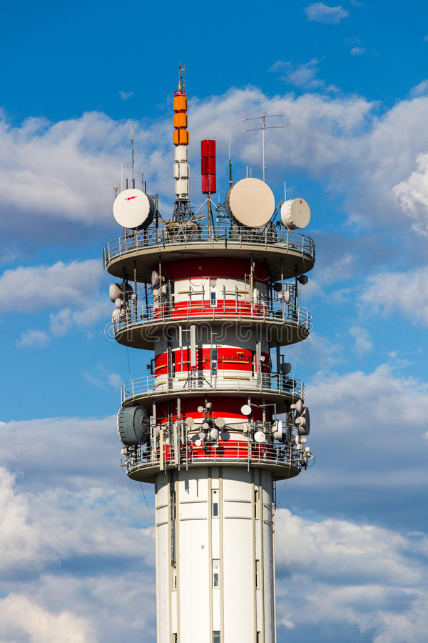 Telecommunication tower with antennas and blue sky.  royalty free stock images