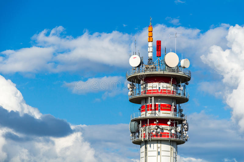 Telecommunication tower with antennas and blue sky.  royalty free stock image
